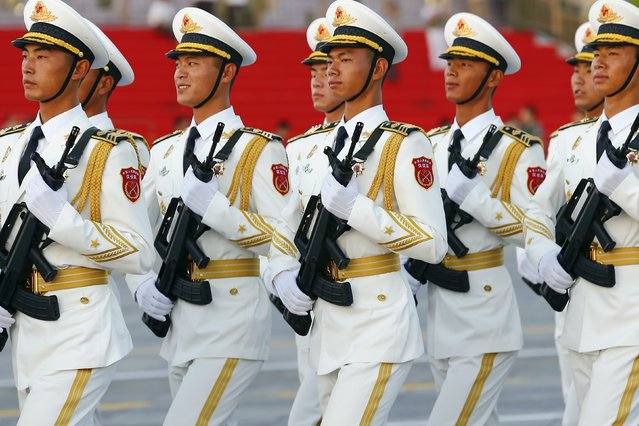 Honour guards of the People's Liberation Army (PLA) of China march in formation past the Tiananmen Square before a military parade to mark the 70th anniversary of the end of World War Two, in Beijing, China, September 3, 2015. (Photo by Damir Sagolj/Reuters)