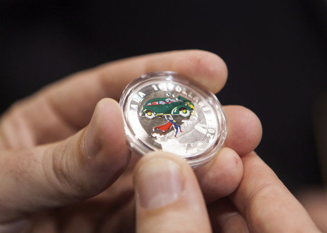 One of four new collector coins from the Royal Canadian Mint featuring Superman are displayed during an unveiling ceremony at Fan Expo in Toronto on Friday, August 29, 2014. (Photo by Jesse Johnston/The Canadian Press)