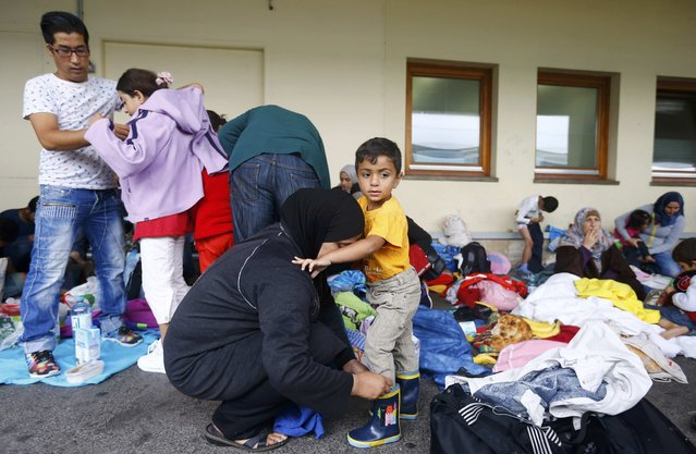 Clothing is distributed to migrants after they disembarked from a train at a railway station in Vienna, Austria September 5, 2015. (Photo by Dominic Ebenbichler/Reuters)