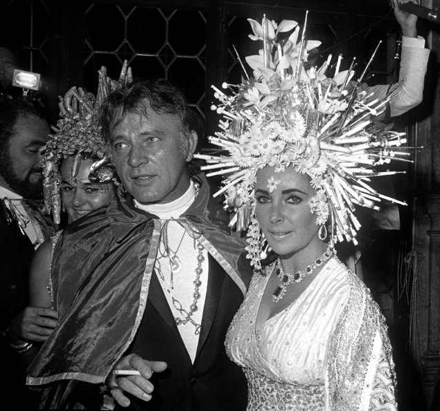 Actors Richard Burton and Elizabeth Taylor appear during the masked ball at the Ca' Rezzonico in Venice, September 9, 1967. Ms. Taylor's hairstyle is by French stylist Alexandre. (Photo by AP Photo)