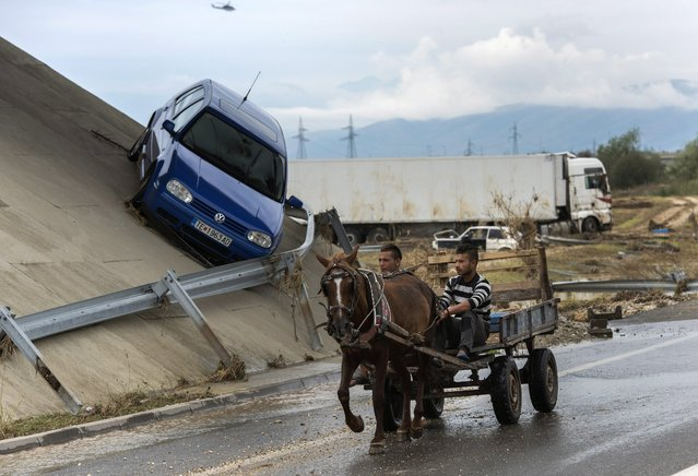 A damaged vehicle is seen next to the ring road, around Skopje, near the village of Stajkovci, Skopje, The Former Yugoslav Republic of Macedonia, 08 August 2016. At least 21 people have died and more than 100 are injured in the heavy rain storm that hit the Macedonian capital Skopje late Saturday night causing severe damage to the roads and house infrastructure. More than 80 vehicles were hit by landslides at Skopje's ring road. The highway remains closed. The government announced a 15-day state of emergency in the Skopje and Tetovo region. (Photo by Georgi Licovski/EPA)