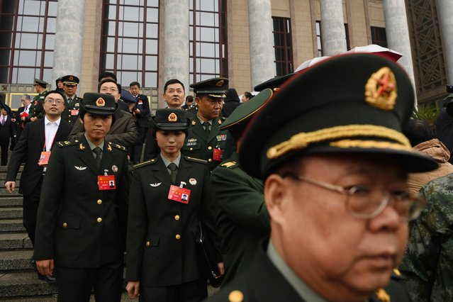 Chinese military delegates leave after the opening cereony of the 19th Communist Party Congress in Beijing's Great Hall of the People on October 18, 2017. The Chinese Communist Party opens its week-long, twice-a-decade congress in the Great Hall of the People. (Photo by Greg Baker/AFP Photo)