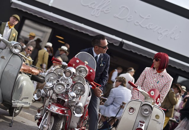 Visitors and car enthusiasts attend the Goodwood Revival historic motor racing festival in Goodwood, near Chichester in south England, Britain, September 11, 2015. (Photo by Toby Melville/Reuters)