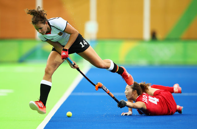 Janne Muller-Wieland of Germany is challenged by Jungeun Seo of Korea during the Women's Pool B Match between Germany and Korea on Day 5 of the Rio 2016 Olympic Games at the Olympic Hockey Centre on August 10, 2016 in Rio de Janeiro, Brazil. (Photo by Mark Kolbe/Getty Images)