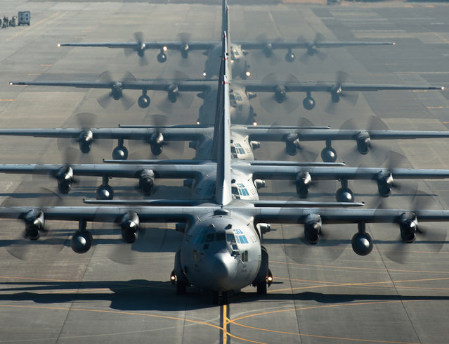 Six C-130 Hercules line up before flying a sortie during a readiness week at Yokota Air Base, Japan. The 374th Airlift Wing uses C-130s to support operations in the Pacific. (Photo by USAF)