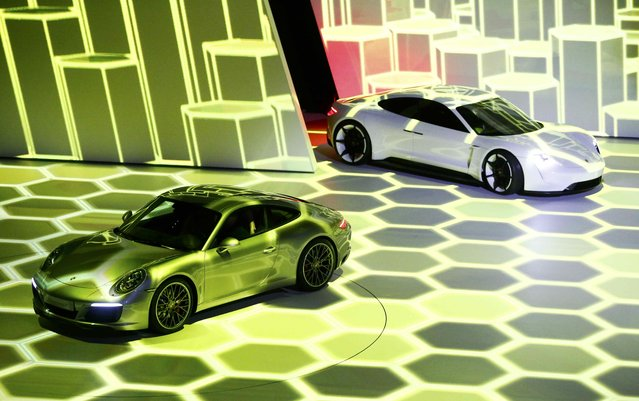 The new Porsche 911 Carrera S (L) and concept car Mission E are presented during the Volkswagen group night ahead of the Frankfurt Motor Show (IAA) in Frankfurt, Germany, September 14, 2015. (Photo by Kai Pfaffenbach/Reuters)