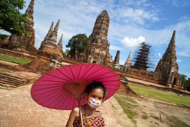 A woman wearing a protective face mask and dressed in traditional costume visits Wat Chaiwatthanaram after the Thai government eased isolation measures to prevent the spread of the coronavirus disease (COVID-19) in the city of Ayutthaya Historical Park, Thailand, June 1, 2020. (Photo by Athit Perawongmetha/Reuters)