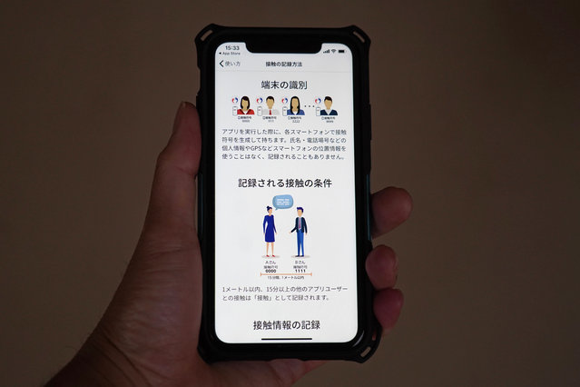 The smartphone screen, seen in Yokohama, Japan, shows a trial version of the COVID-19 Contact Confirming Application, or COCOA, released Friday, June 19, 2020, by the Ministry of Health, Labor and Welfare. The notice explains how to record the history of the user's contacts. The coronavirus tracing app is designed to alert users if they come in contact with someone tested positive for the coronavirus.  Once installed, the app logs data via Bluetooth from phones that stay in close proximity for over 15 minutes. (Photo by Shuji Kajiyama/AP Photo)