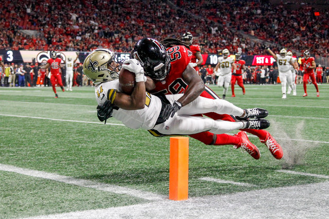 New Orleans Saints wide receiver Tommylee Lewis (11) dives in for a touchdown while being hit by Atlanta Falcons linebacker De'Vondre Campbell (59) in the second quarter at Mercedes-Benz Stadium in Atlanta, GA, USA on December 7, 2017. (Photo by Brett Davis/USA TODAY Sports)