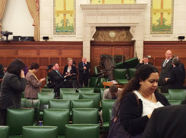 The Conservative Party caucus room is shown shortly after shooting began on Parliament Hill, in Ottawa, Ontario, October 22, 2014. (Photo by MP Nina Grewal/Reuters)