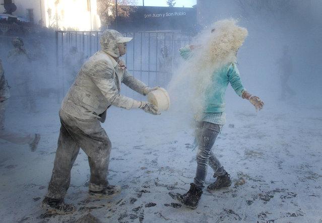 Powder war... Els Enfarinats festival! (Photo by Alberto Saiz/AP Photo)