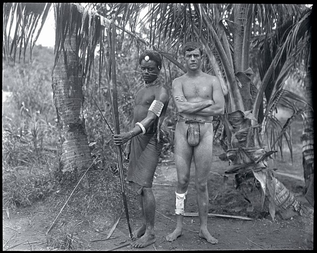 The American adventurer and film director Martin Johnson, one of the members of the Snark crew, poses with a native of the Solomon Islands. Guadalcanal, 1908. (Photo by Jack London/Courtesy of Contrasto)