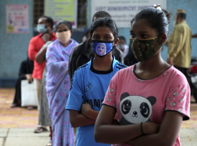People wait in a queue give their nasal swab samples to test for COVID-19 in Hyderabad, India, Saturday, August 22, 2020. (Photo by Mahesh Kumar A./AP Photo)