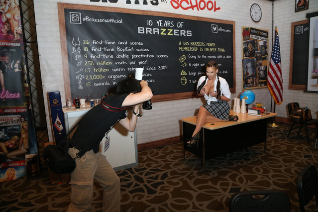 A photographer takes photos of adult film actress Phoenix Marie at the 2015 AVN Adult Entertainment Expo at the Hard Rock Hotel & Casino on January 22, 2015 in Las Vegas, Nevada. (Photo by Gabe Ginsberg/FilmMagic)