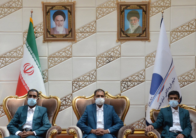 Three Iranian fishermen, who, according to maritime security officials, were released by Somali pirates after being held for five years, pose for a photo in the VIP hall of Imam Khomeini Airport, in Tehran, Iran on August 21, 2020. (Photo by WANA (West Asia News Agency) via Reuters)