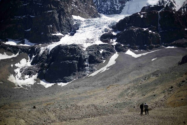 """A view of """"La Paloma"""" glacier next to the open pits of CODELCO's Andina and Anglo American's Los Bronces copper mines (not pictured) at Los Andes Mountain range, near Santiago city, November 17, 2014. (Photo by Ivan Alvarado/Reuters)"""