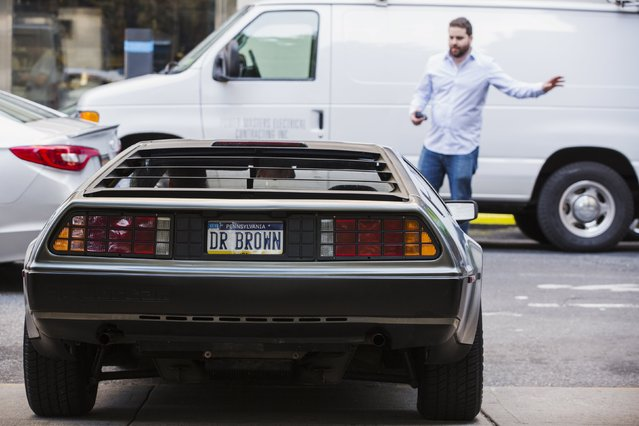 """A DeLorean Motor Company DMC-12 with vanity plates related to the film """"Back to the Future Part II"""" takes part in a Lyft promotion in New York, October 21, 2015. (Photo by Lucas Jackson/Reuters)"""