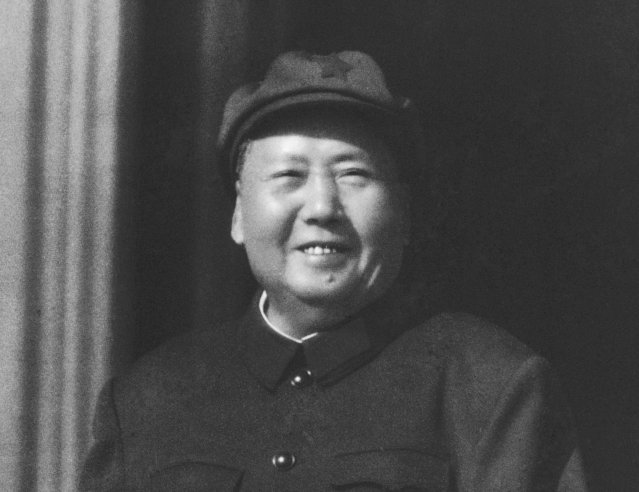 In this file photo from 1966, former Chinese leader Mao Zedong observes Cultural Revolution inspired Red Guards assembled in Beijing's Tiananmen Square. Monday, May 16, 2016 marks the 50th anniversary of a 1966 party meeting that spearheaded the 10-year Cultural Revolution, a violent and frequently chaotic attempt by Mao to reassert his power and revive his party's egalitarian ideals. (Photo by AP Photo)