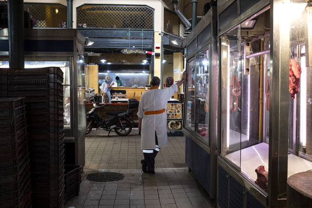 A butcher stands outside a butcher shop inside Athens' main meat market, in Athens, Thursday, September 3, 2020. Greece has suffered a huge drop in output in the second quarter of the year, plummeting 15.2% on an annual basis, but the government insisted the figures did not worsen the country's annual outlook. (Photo by Yorgos Karahalis/AP Photo)