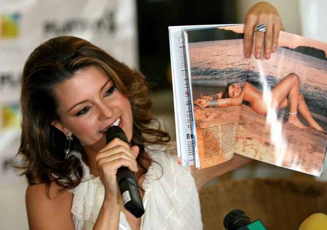 "This file photo taken on February 7, 2006 shows Venezuelan Alicia Machado, former Miss Universe 1996, as she holds February's issue of Playboy Mexico magazine open in a double page with her picture in Mexico City. Fresh off his presidential clash with Hillary Clinton, Donald Trump doubled down September 27, 2016 on criticism of a former Miss Universe he accused of getting too fat, comments that could repel women voters. Alicia Machado, who won the crown in 1996, has accused Trump – whose company owned the Miss Universe pageant until last year – of calling her ""Miss Piggy"" and ""Miss Housekeeping"", and publicly humiliating her over her post-victory weight gain. (Photo by Joseph L. Hughes/AFP Photo)"