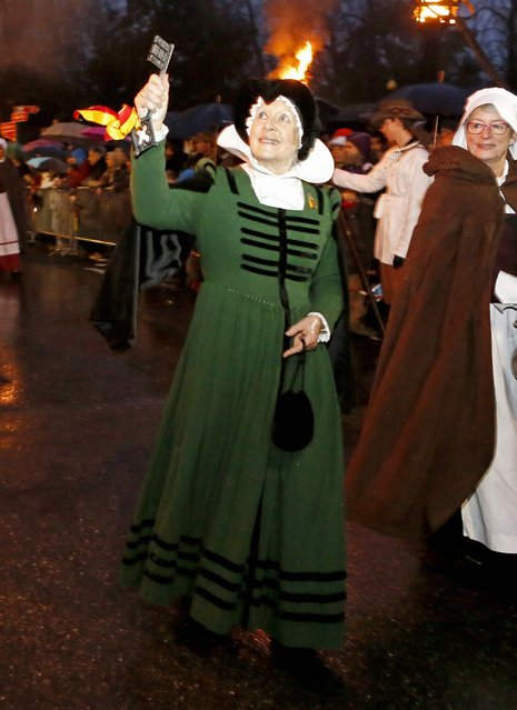 A member of Compagnie 1602 playing the role of Mere Royaume is pictured during a procession in Geneva December 14, 2014. (Photo by Pierre Albouy/Reuters)