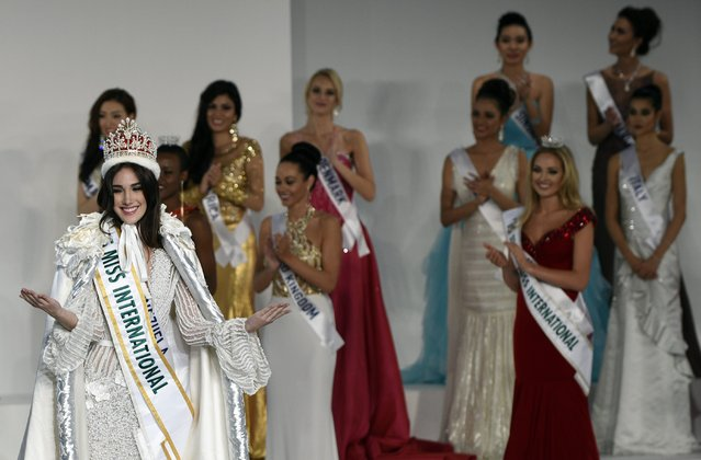 Miss Venezuela Edymar Martinez (L) reacts after winning the title of the Miss International Beauty Pageant 2015 in Tokyo, Japan, 05 November 2015. Representatives from more than 65 countries and regions took part in the annual event. (Photo by Franck Robichon/EPA)