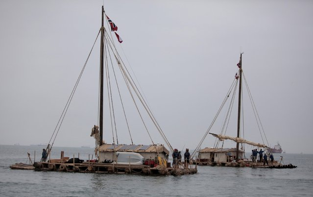 Two wooden rafts of the Kon-Tiki2 expedition depart from Peru's Callao Naval Shipyard in Peru, November 7, 2015. A team of explorers departed on Saturday by raft from Peru on an 8,000 kilometre (5,000 mile) journey destined for Easter Island and Valparaiso, Chile. They expect the mammoth journey to take approximately four months to complete with the first leg from Lima to Easter Island to take about six weeks. (Photo by Guadalupe Pardo/Reuters)