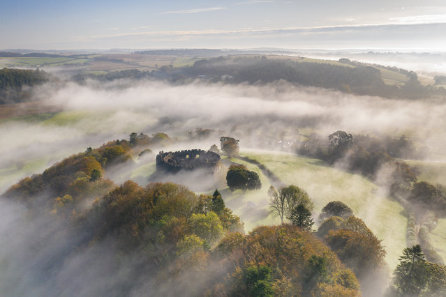 Restormel Castle surrounded by morning mist, Lostwithiel, Cornwall, England. Autumn (October) 2019. (Photo by Adam Burton/Historic Photographer of the Year 2020)