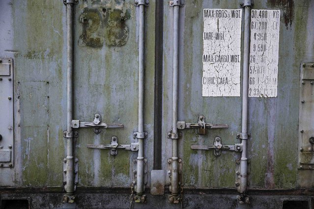 The closed doors of a container with personal possessions of 2004 tsunami victims are seen outside a police station in Takua Pa, in Phang Nga province December 19, 2014. Thai police opened a shipping container filled with documents and possessions of victims of the 2004 Indian Ocean Tsunami after being asked by Reuters for permission to film its contents. (Photo by Damir Sagolj/Reuters)