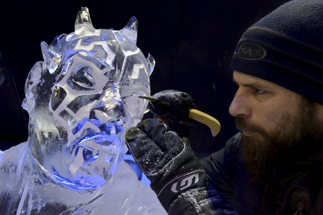 Canada's Jonathan Bouchard carves a Star Wars character for the ice sculpture festival in Liege, Belgium, November 13, 2015. (Photo by Eric Vidal/Reuters)