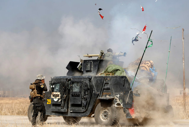 An Iraqi special forces soldier fires a cannon at Islamic States fighters in Bartella, east of Mosul, Iraq October 20, 2016. (Photo by Goran Tomasevic/Reuters)