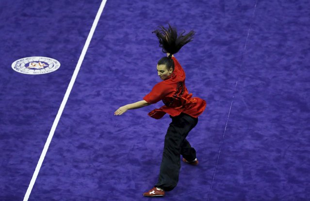Italy's Roberta Palma competes in the women's compulsory changquan final during the 13th World Wushu Championship 2015 at Istora Senayan stadium in Jakarta, November 17, 2015. (Photo by Reuters/Beawiharta)