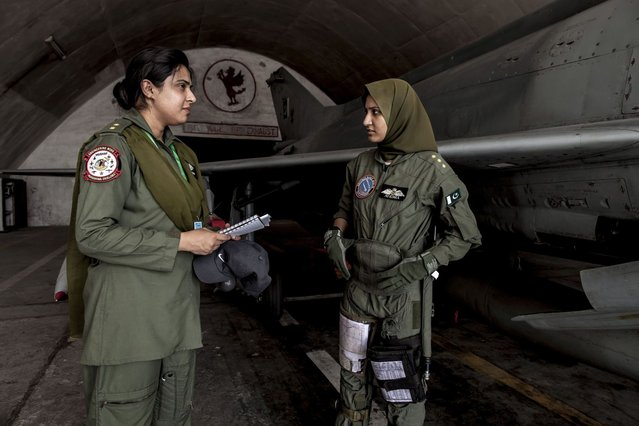 Ayesha Farooq, 26, (R) Pakistan's only female war-ready fighter pilot, talks with avionics engineer Anam Hassan, 24, at Mushaf base in Sargodha, north Pakistan June 7, 2013. (Photo by Zohra Bensemra/Reuters)