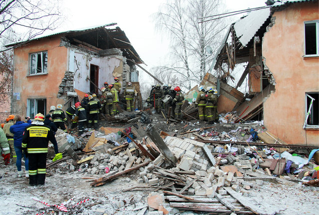 In this Sunday, November 6, 2016 photo, emergency rescue teams dig through rubble after an explosion at brick building in Ivanovo, 250 kilometers (150 miles) northeast of Moscow, Russia. Russian emergency officials say the explosion was caused by a gas leak in the apartment building shortly before dawn. (Photo by TASS/Barcroft Images)