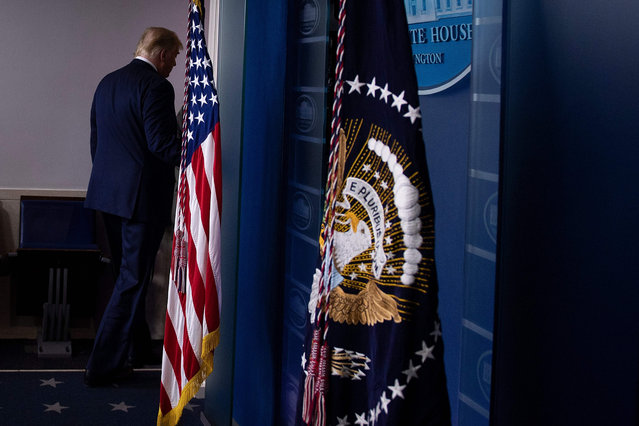 US President Donald Trump leaves after addressing the press from the Brady Briefing Room at the White House in Washington, DC on November 5, 2020. Democrat Joe Biden is leading President Donald Trump in the race for the 270 electoral votes that will put one of them over the top, with the Democrat's campaign asserting they believe he has enough votes to win in key battleground states that remain undecided, like Pennsylvania. (Photo by Brendan Smialowski/AFP Photo)