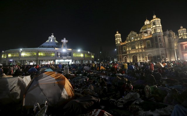 Pilgrims sleep an improvised camp site at the Basilica of Guadalupe during the annual pilgrimage in honor of the Virgin of Guadalupe, patron saint of Mexican Catholics, in Mexico City, Mexico December 11, 2015. (Photo by Henry Romero/Reuters)