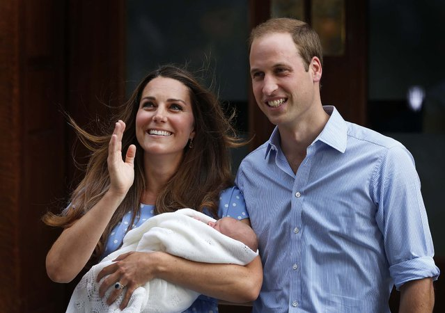 Britain's Prince William and Kate, Duchess of Cambridge hold the Prince of Cambridge as they pose for photographers outside St. Mary's Hospital exclusive Lindo Wing in London where the Duchess gave birth on Monday. (Photo by Lefteris Pitarakis/Associated Press)