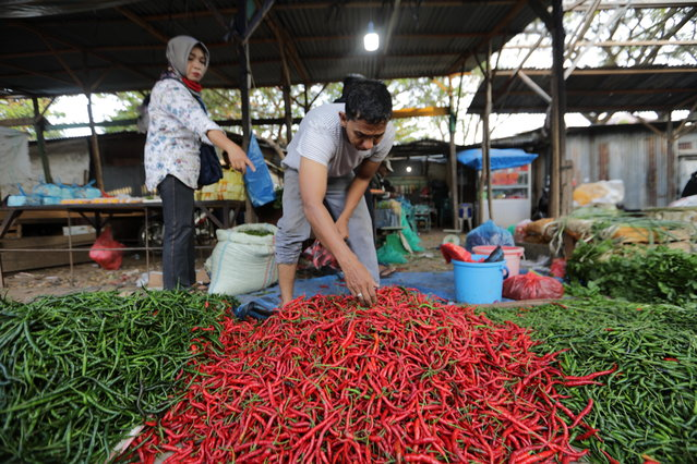 Traders display their chilies at a traditional market in Banda Aceh, Indonesia, 22 February 2021. According to The Bank of Indonesia, in 2021 the Indonesian gross domestic product (GDP), an indicator of economic growth, is expected to reach 4.3 to 5.3 percent, a revised and conservtive forecast issued due to concerns that increasing COVID-19 cases will stall economic growth. (Photo by Hotli Simanjuntak/EPA/EFE)