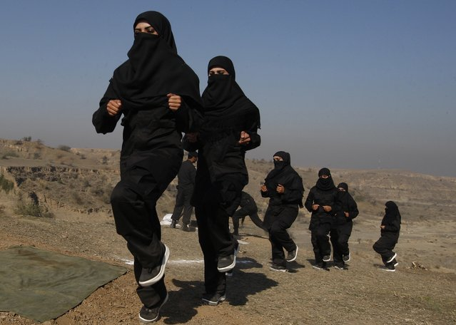 Pakistani female police commandos attend a training session in Nowshera, near Peshawar, Pakistan, Wednesday, February 11, 2015. Authorities formed a Special Combat Unit after Taliban militants stormed a Peshawar school on Dec. 16, 2014 and massacred 150 children and teachers. (Photo by Mohammad Sajjad/AP Photo)