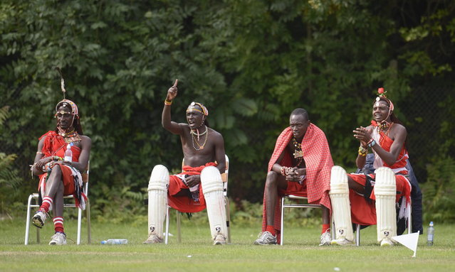 "Members of the Maasai Cricket Warriors team from Kenya watch their match against English team ""The Shed"", during the ""Last Man Stands"" cricket tournament at Dulwich sports ground in South London September 1, 2013. (Photo by Philip Brown/Reuters)"