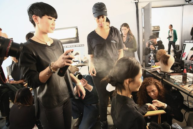 A model prepares backstage at the Marissa Webb fashion show with TRESemme during Mercedes-Benz Fashion Week Fall 2015 on February 12, 2015 in New York City. (Photo by Astrid Stawiarz/Getty Images for TRESemme)