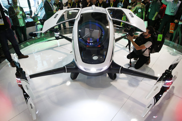 The EHang 184 autonomous aerial vehicle is unveiled at the EHang booth at CES International, Wednesday, January 6, 2016, in Las Vegas. The drone is large enough to fit a human passenger. (Photo by John Locher/AP Photo)