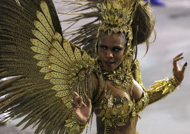 A reveller from the Imperio da Casa Verde Samba School takes part in a carnival at Anhembi Sambadrome in Sao Paulo February 15, 2015. (Photo by Paulo Whitaker/Reuters)