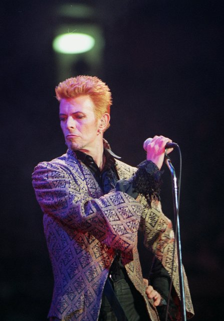 In this January 9, 1997, file photo, David Bowie performs during a concert celebrating his 50th birthday, at Madison Square Garden in New York. Bowie, the innovative and iconic singer whose illustrious career lasted five decades, died Monday, January 11, 2016, after battling cancer for 18 months. He was 69. (Photo by Ron Frehm/AP Photo)