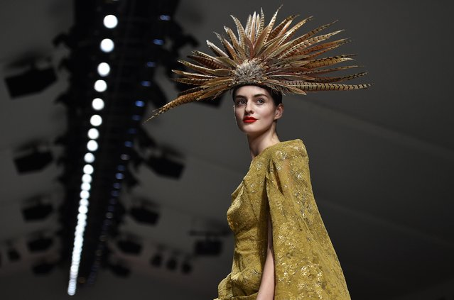 A model presents a creation during the Fashion for Relief charity catwalk show ahead of London Fashion Week in London February 19, 2015. (Photo by Toby Melville/Reuters)