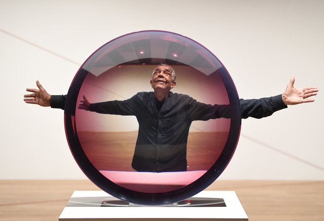 US artist Fred Eversley poses with his work Untitled (Parabolic Lens) at the preview of Space Shifters at the Hayward Gallery in London, Britain, 25 September 2018. The exhibition features the work of 20 artists that alter or disrupt the visitors sense of space. The show runs from 26 September 2018 to 06 January 2019. (Photo by Neil Hall/EPA/EFE)