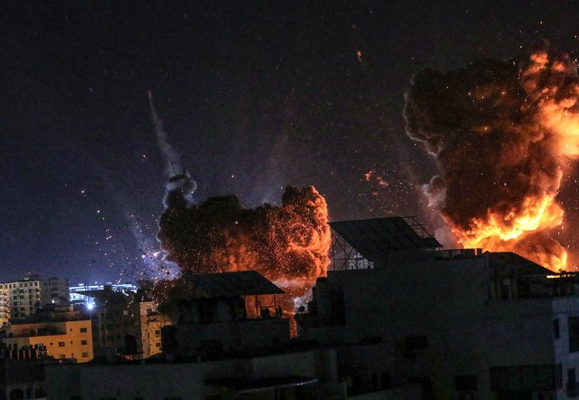 Smoke and flames rise following an Israeli air strike on Gaza City, 18 May 2021. Tensions have escalated in the region, following days of violent confrontations between Israeli security forces and Palestinians in Jerusalem, leading to the heaviest offensive in years. (Photo by Mohammed Saber/EPA/EFE)