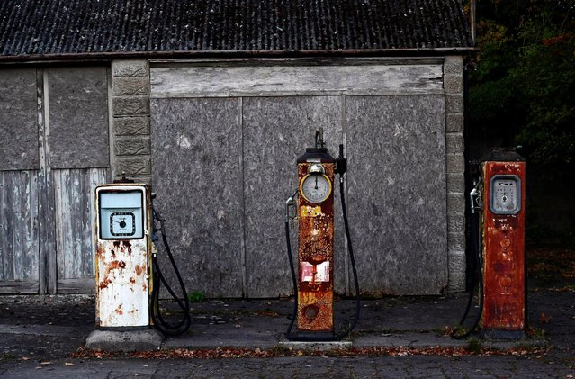 Rusting old petrol pumps outside a long-closed rural village petrol station are seen on a minor road near Trowbridge, Britain, October 21, 2016. (Photo by Toby Melville/Reuters)