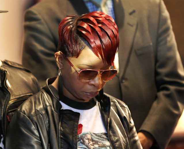 Lesley McSpadden, mother of Michael Brown Jr., listens to the family attorney during a news conference, Thursday, March 5, 2015, in Dellwood, Mo. Neither McSpadden nor Brown's father, Michael Brown Sr., spoke or took questions. The Justice Department on Wednesday cleared former Ferguson, Mo., police Officer Darren Wilson in the fatal shooting of Michael Jr., but also issued a scathing report calling for sweeping changes in city law enforcement practices it called discriminatory and unconstitutional. (AP Photo/Charles Rex Arbogast)