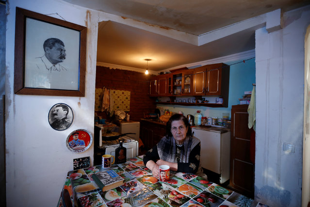 """Retired librarian Tsitsino Tsintsadze, 77, poses for a portrait at her home in Tbilisi, Georgia, November 29, 2016. """"I have portraits of Stalin, books about him, souvenirs. Some I bought, some were given to me. My relatives and friends know about my love of Stalin and often gift me memorabilia"""", Tsintsadze said. (Photo by David Mdzinarishvili/Reuters)"""